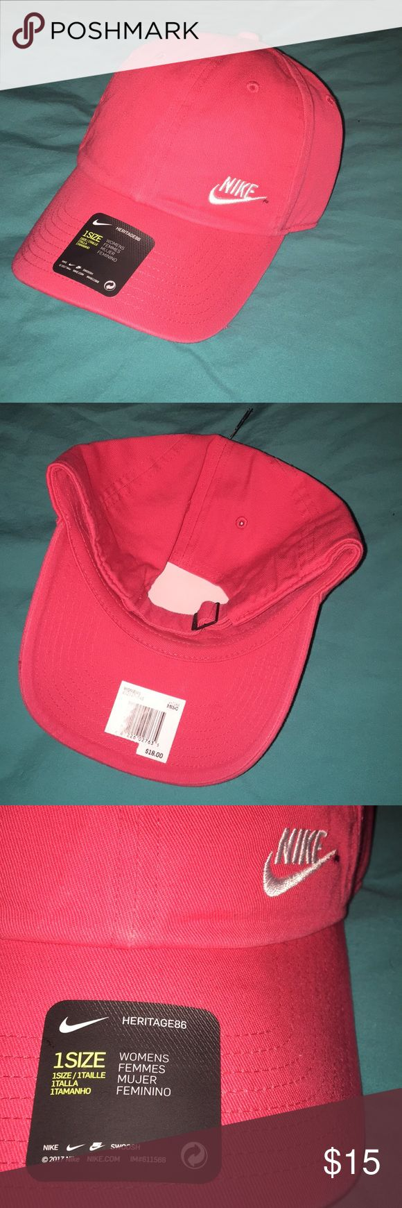 NWT Women's Nike Hat NWT women's Nike tag. The color is like a dark pink/light red Nike Accessories Hats
