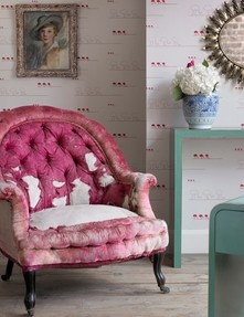 Ostrich Wallpaper with a hot pink chair.
