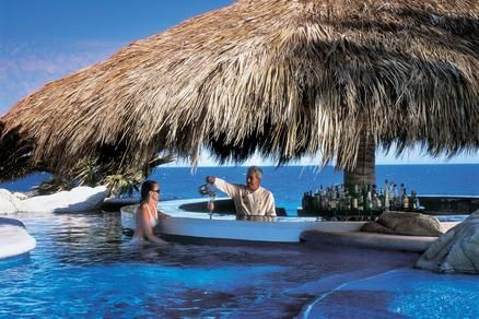 The swim-up bar & lounge at The One & Only in Los Cabos Mexico. Now that's just cool!