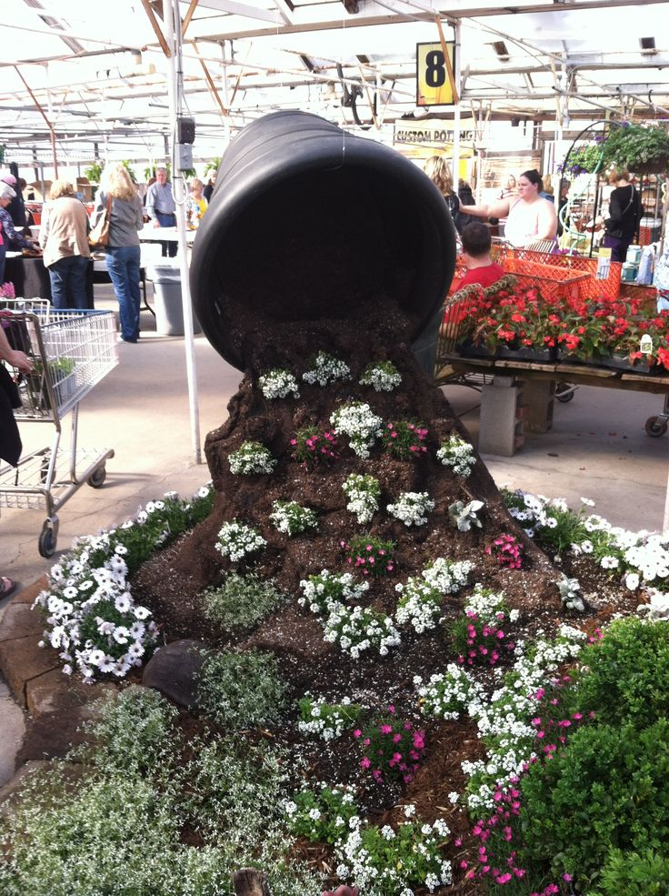 An awesome display one of our customers made in their garden center! I can't wait to see it in full bloom. One of our All-Weather Poly Pots suspended to look like it is spilling out flowers. Great use of creativity. Visit our website, www.craftwareusa.com, to see our wide selection of wholesale products.
