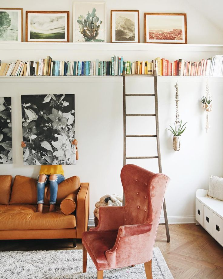 home, interior, velvet armchair, simple, living room, high shelving, books, storage, colour, picture shelf