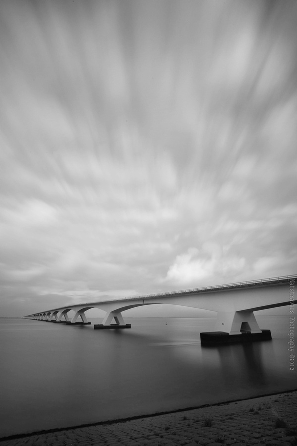 The Zeeland Bridge (Dutch: Zeelandbrug) is the longest bridge in the Netherlands. The bridge spans the Oosterschelde estuary. It connects the islands of Schouwen-Duiveland and Noord-Beveland in the province of Zeeland. The Zeeland Bridge was built between 1963 and 1965. At the time of its completion, it was the longest bridge of Europe. It has a total length of 5,022 metres, and consists of 48 spans of 95 metres, 2 spans of 72.5 metres and a movable bridge with a width of 40 metres.