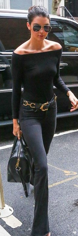 Kendall Jenner in Jeans – Rag & Bone  Shirt- H&M  Sunglasses – Saint Laurent  Purse – Givenchy
