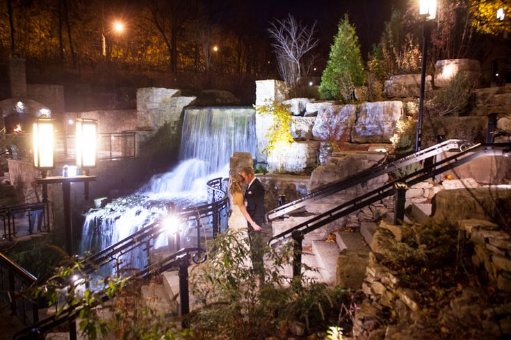 Ancaster Mill bride and groom near waterfalls at night