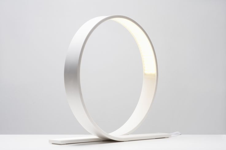 Loop  Finnish designer and co-founder of Aimo Design, Timo Niskanen has created the beautifully minimal Loop table lamp. The efficient loop shaped LED lamp is designed to stand the test of time by remaining classic and stately in its form. This lamp strongly reflects his philosophy on design: