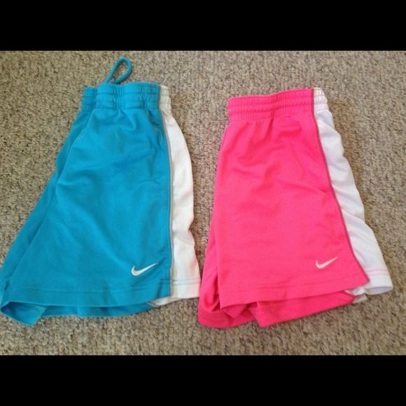 Nike soccer shorts Lot of 2 nike shorts. One is teal and one is hot pink. Just don't play soccer anymore so I don't need them Nike Other