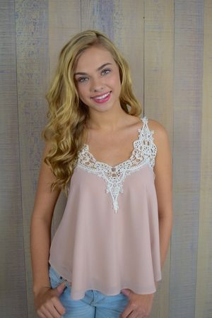 Victoria Lace Cami  Definitely not your basic cami, this Version is cut into a boxy chiffon silhouette (which perfectly catches the breeze) and is outfitted an ornate lace trim along the V-neckline. Your Romantic everyday essential has arrived.