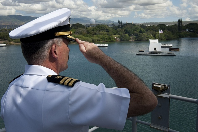The XO of USS Pearl Harbor salutes the USS Arizona Memorial as the ship passes it while entering port. by Official U.S. Navy Imagery, via Flickr