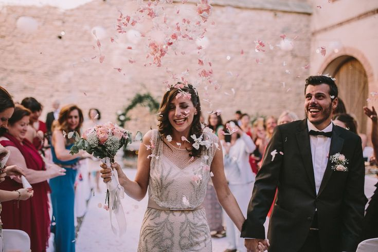 Rose petals were thrown to the newlywed