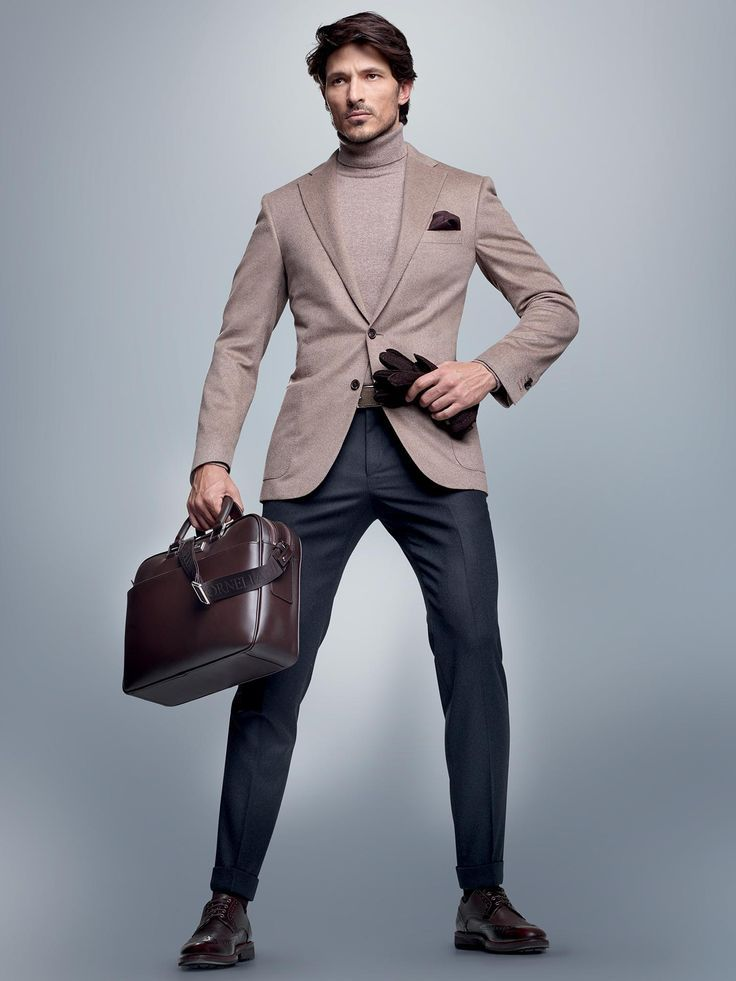 Shop this look on Lookastic:  http://lookastic.com/men/looks/turtleneck-pocket-square-blazer-gloves-briefcase-dress-pants-brogues/8462  — Beige Turtleneck  — Dark Brown Pocket Square  — Beige Blazer  — Dark Brown Leather Gloves  — Dark Brown Leather Briefcase  — Navy Dress Pants  — Dark Brown Leather Brogues