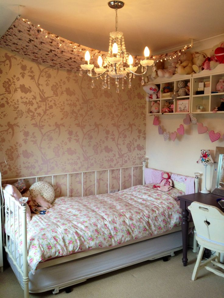 Bed canopy made with a ladies wrap and curtain poles.