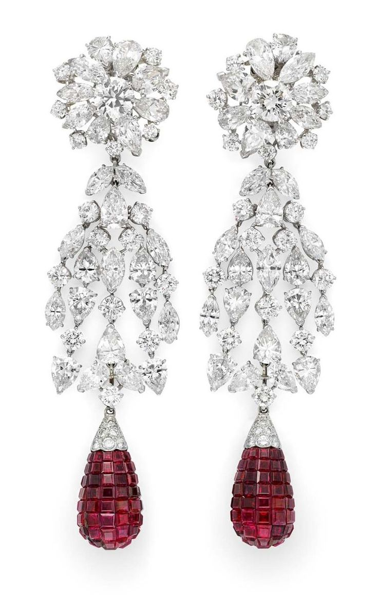 Art Deco  Simon Teakle Fine Jewellery, USA, is exhibiting a rare pair of Van Cleef & Arpels mystery set ruby and diamond earrings circa 1930.