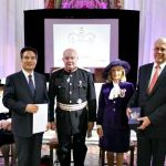 Michael King and Kim Joo-cheol from the World Mission Society of God attended a garden party at Buckingham Palace on 24 May where they met the Queen and other winners of this year's award.