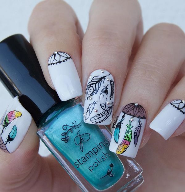 Multicolored Feather-y Nail Art. Although this nails art is bit complicated, but once it is completed, it is the best thing to have on nails. The punch of multi-colors over the white base gives extraordinary look to this design.
