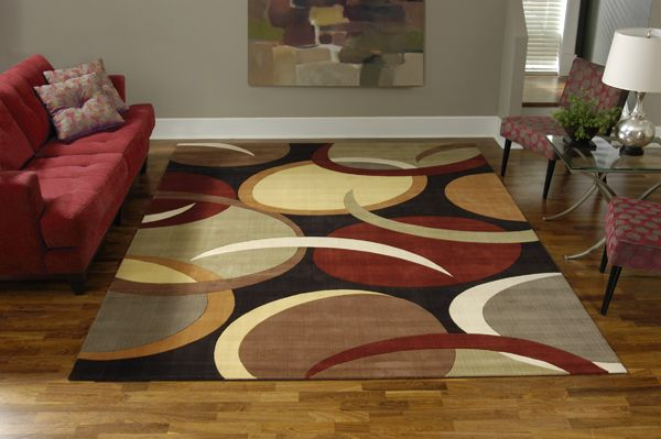 Area rugs are a fantastic way to add color, warmth and comfort to any room or office space, as well as gain some of the benefits of carpet. Area rugs create maximum impact in minimum space, sparking visual interest and muffling sound.