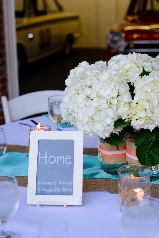 Table centerpieces with teal coral and burlap mason jars