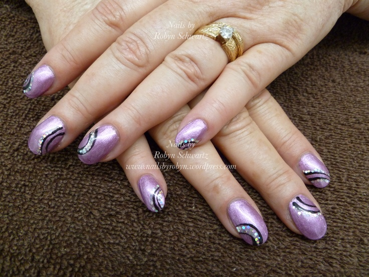 Gel nails, purple awesomeness and big bling.