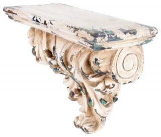 """Raft de perete """"Antique"""" - bogat ornamentat aduce aminte de capitelurile antichităţii. Farmecul său clasic este accentuat de vopseaua scorojită ce-i dă aerul unei poliţe pe care timpul s-a aşezat să se odihnească.  http://www.retroboutique.ro/mic-mobilier/mic-mobilier/raft-de-perete-antique-1222"""