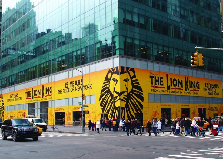 The Award Winning Musical Broadway Disney's The Lion King. Flashing At The Walls Of A Building In New York
