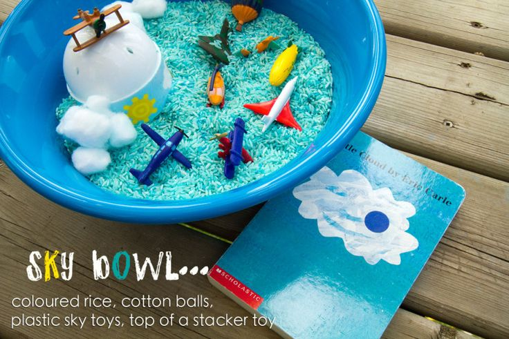Sky exploration bowl. colored rice, cotton balls, planes, helicopters, Little cloud book by Eric Carle. Love