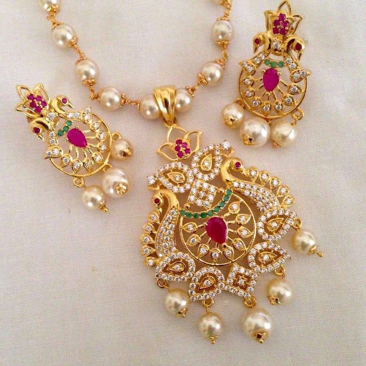CZ and ruby stone pendant set Code : PS 373 Price: Rps. 1295/- Whatsap to 09581193795 for order processing