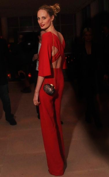 Red is a great color for the season, of course!  Lauren Santo Domingo is wearing a Valentino jumpsuit.