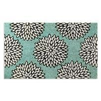 EXCLUSIVE. Contemporary sophistication to the coir: cream colored blooms, outlined in black, on a classically modern robin's egg blue background. Fade-resistant dyes on a sustainable coconut fiber that's a natural for trapping dirt. Rubber back. Hand woven.