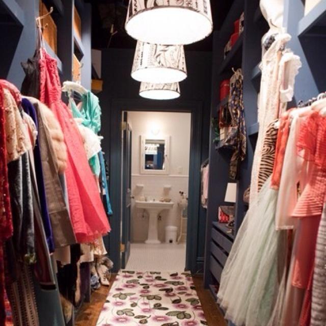 narrow walk-in closet ... love the dark backdrop color #carriebradshaw