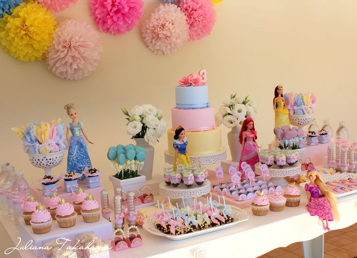 make it a purple princess party and set up the cake table with the princess barbies....