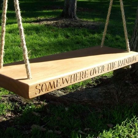 Bespoke wooden garden swing personalised with your own wording