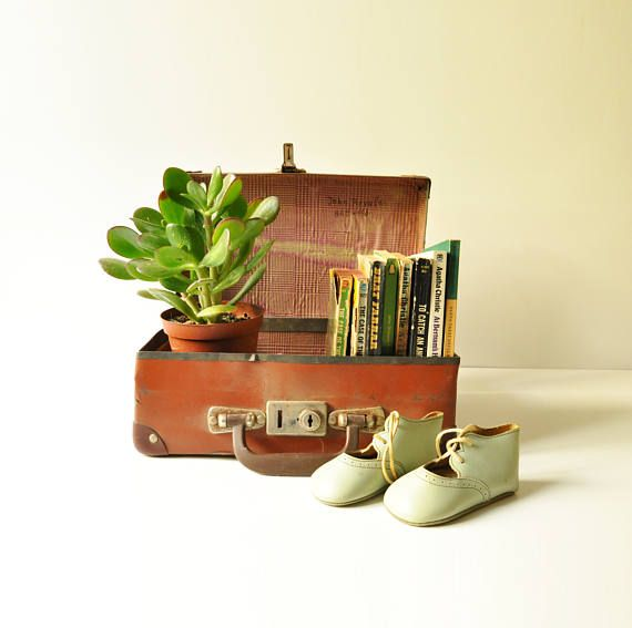 This beautiful small suitcase dates back to the late 1940s. It carries the name of its previous owner written on the inside paper lining.  This suitcase would definitely look gorgeous stacked with other luggage for a side table or room decor. Would also make a great photo prop!  Dimensions: 30 cm X 20 cm X 10 cm  In good vintage condition overall, it does show rust on the metal parts.  This listing is only for the suitcase it doesnt include the other items shown in photo 1…