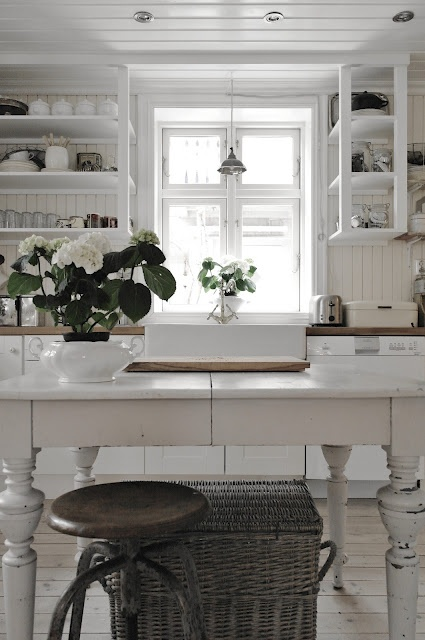Sometimes the best looking kitchens are the simple ones.  No flash and grandness about them.  And nothing compliments pure white better than touches of rustic, such as the metal stool and the wicker basket.  I feel calm just looking at this picture.