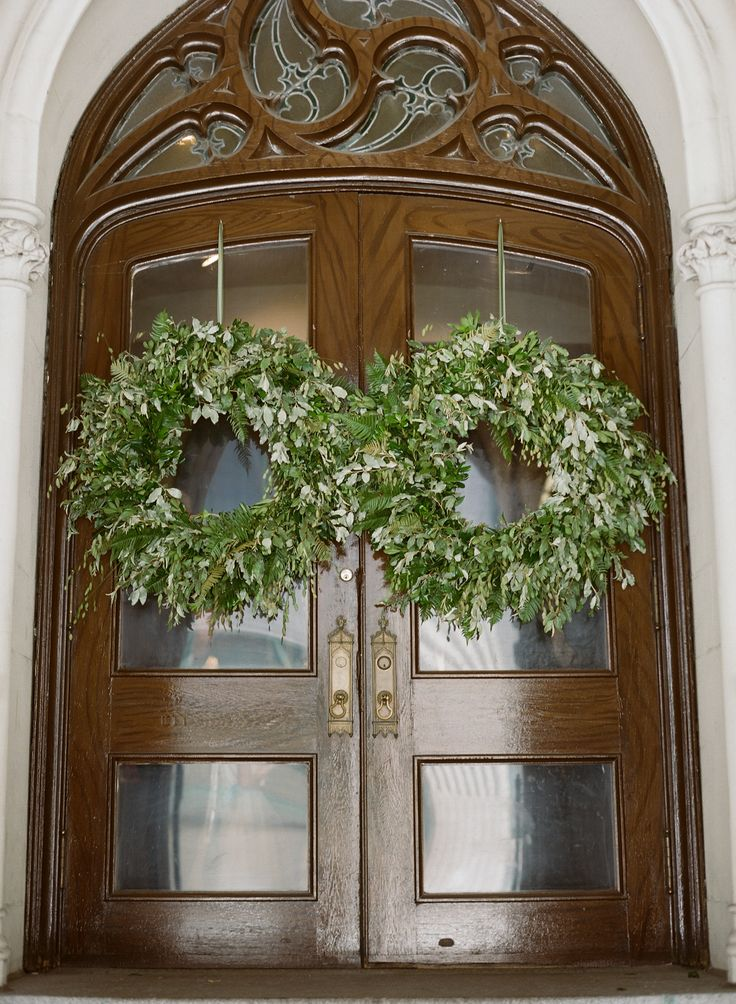 Seasonal fresh wreaths hanging on the church doors for a wedding.  Grown and designed by Love 'n Fresh Flowers.  Photo by Kate Headley.
