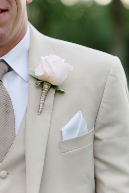 Sand colored three piece tux with soft pink rose boutonniere wrapped in silver wire and white pocket square | Photo: Errol Colon Photographers