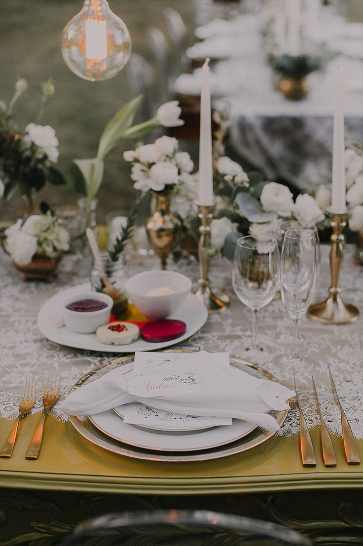 Andrew & Jill's Relaxed Outdoor Wedding at Hawksmoor House Wedding Venue – Stellenbosch  Their tables were adorned with gold accents, white flowers, gold cutlery, naked bulbs and vintage lace runners.