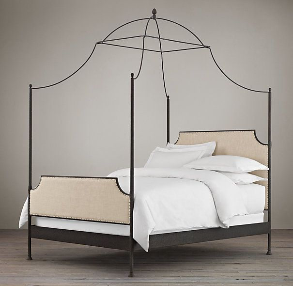 19th C. Campaign Upholstered Iron Canopy Bed at Restoration Hardware. The upholstered version is on special for $1100 but that's online. I like that it won't jam any bulkheads because the four posts only reach the highest point in the middle. To hang fabric along the back section only, you could tie a strong cord between the two back posts and rest the fabric along that.