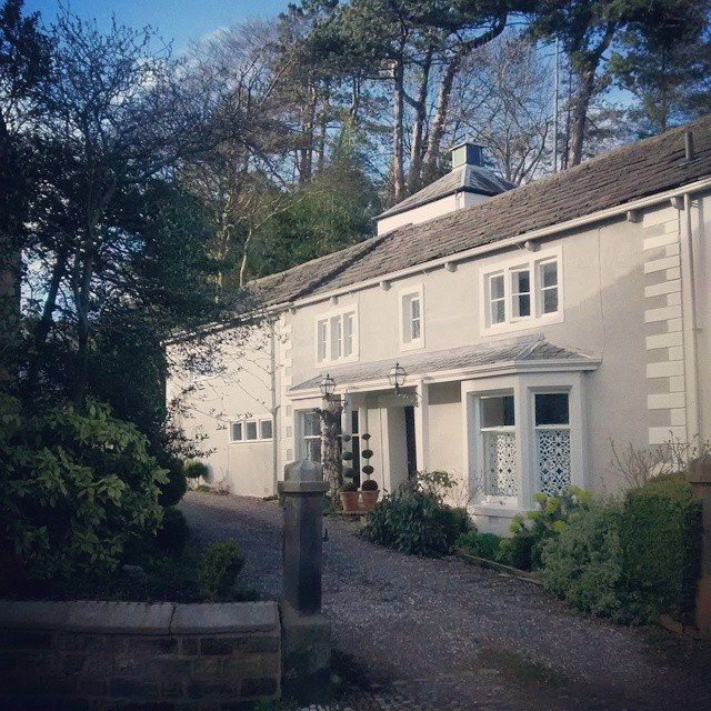 My house exterior. Render painted in Farrow & Ball's 'Hardwick White'. Stone jambs and porch in 'Shaded White' and woodwork in 'Wimborne White'