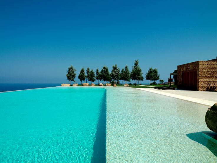 vladimir djurovic / villa sukkar, jiye lebanon infinity edge pool with white rendered interior