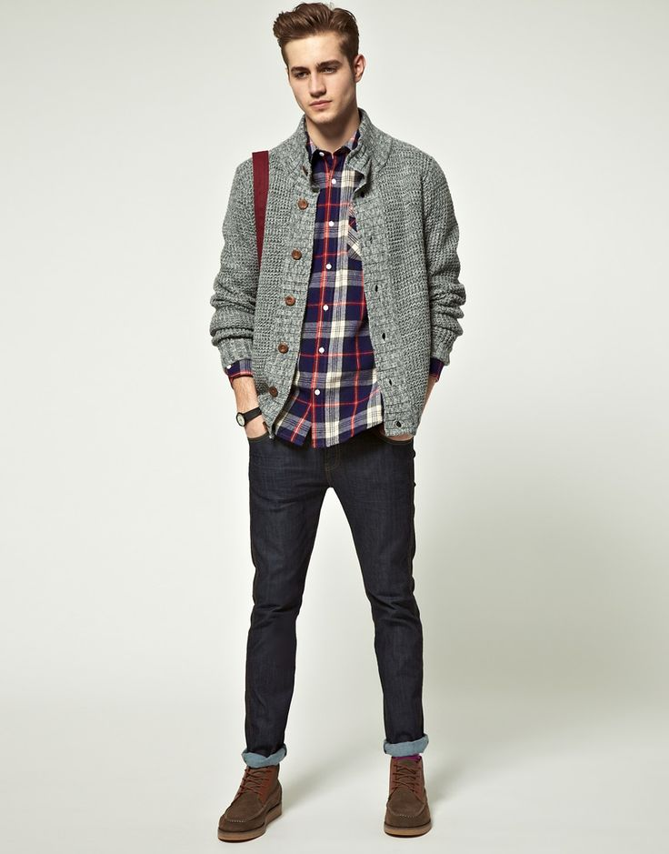 Chunky knit cardigan, check shirt, rolled dark jean, brown moccasin toe boot