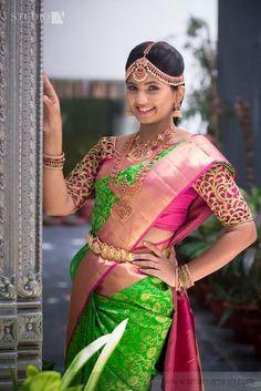 South Indian bride. Gold temple bridal jewelry. Jhumkis.Green kanchipuram sari with contrast pink blouse.Braid with fresh jasmine flowers. Tamil bride. Telugu bride. Kannada bride. Hindu bride. Malayalee bride.Kerala bride.South Indian wedding
