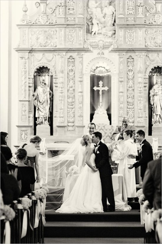 Catholic church wedding ceremony ideas. Tip: Have your maid of honor hold your veil during your kiss for extra cute pictures. #cathedralwedding #ceremony #weddingchicks Captured By: We Heart Photography ---> http://www.weddingchicks.com/2014/04/24/timeless-california-wedding/