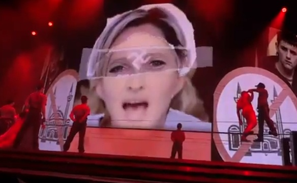 Nipples and Swastikas?  Just Another Night on the Madonna Concert Tour!  http://commonsenseconspiracy.com/2012/07/nipples-and-swastikas-just-another-night-on-the-madonna-concert-tour-legal-action-from-french-authorities-in-the-works/