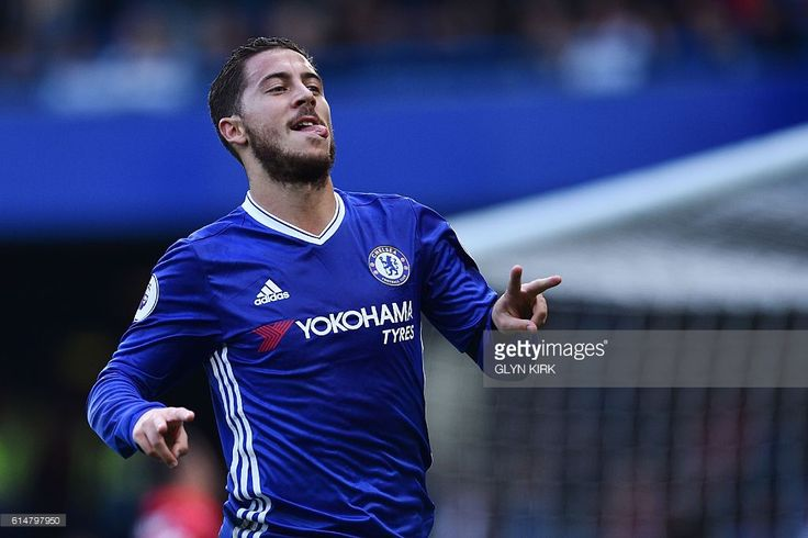 Chelsea's Belgian midfielder Eden Hazard celebrates with a gesture in support of Willian, who's mother passed away recently, after scoring Chelsea's second goal during the English Premier League football match between Chelsea and Leicester City at Stamford Bridge in London on October 15, 2016. / AFP / Glyn KIRK / RESTRICTED TO EDITORIAL USE. No use with unauthorized audio, video, data, fixture lists, club/league logos or 'live' services. Online in-match use limited to 75 images, no video…