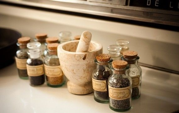Cute little corked bottles- probably can find cheap online somewhere and modge-podge your own labels.  Good idea for storing homegrown herbs.