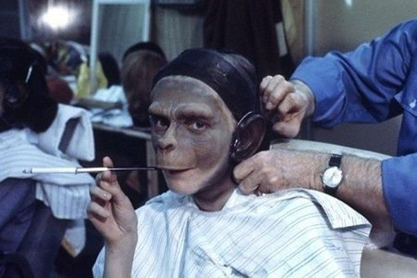 Kim Hunter smoking on a cigarette while her makeup is applied on the set of Planet of the Apes, 1967