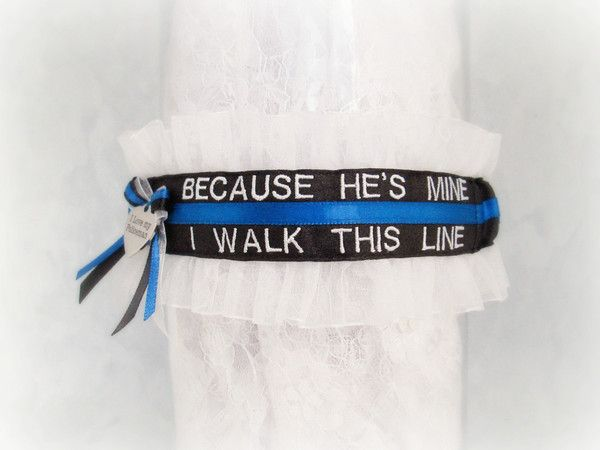 http://www.creativegarters.com/products/thin-blue-line-police-wedding-garter-personalized-custom