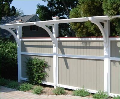 Board Fence with Trellis Topper - A Custom Structure has architectural impact while delivering privacy. The trellis topper is an ideal support for climbing plants.