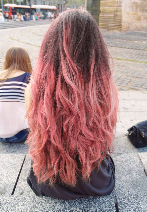 Subtle pink ombre.  My hair is long like this, but curlier.  I love the look, but would not be willing to bleach out so much of my hair.