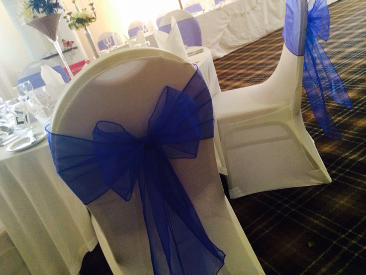 Royal blue organza sash on white spandex cover  By Made Marvellous