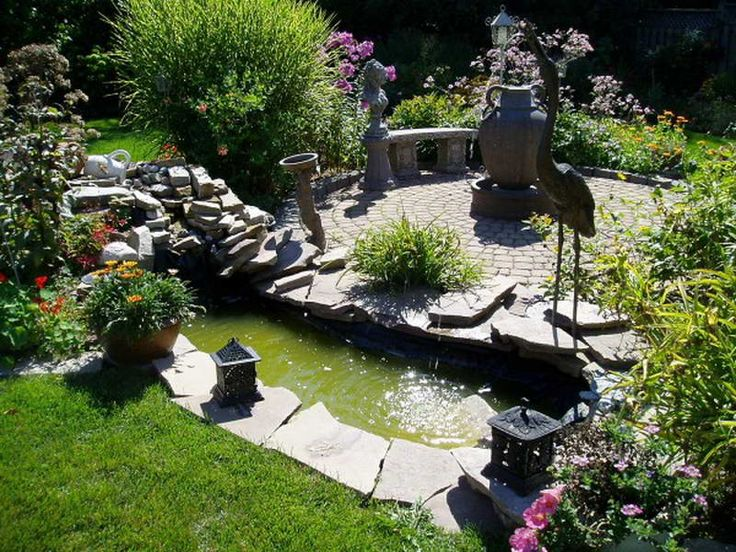 Small Backyard Landscaping Ideas: Flat flagstones around pond with rock 'wall' -- I want something more even.